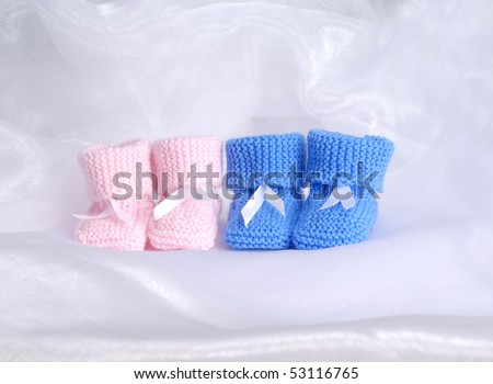 pink and blue baby booties - stock photo