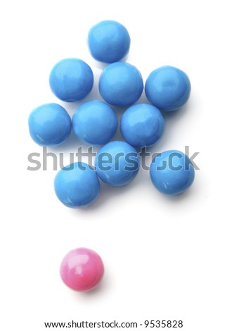 pink and blue bubble gum balls isolated on white - concept for females versus males and sex discrimination - stock photo
