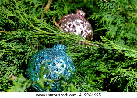 Pink and blue Christmas balls on green pine needles, Santa Claus, Christmas time - stock photo