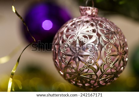 Pink and blue Christmas ornament with a Christmas tree - stock photo