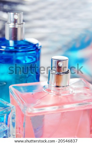 pink and blue perfume bottle detail - stock photo