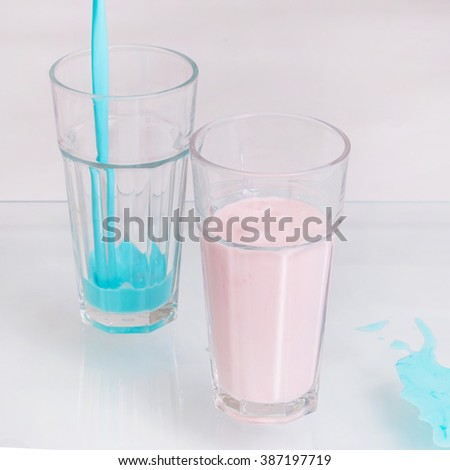 Pink and blue shake in two glasses