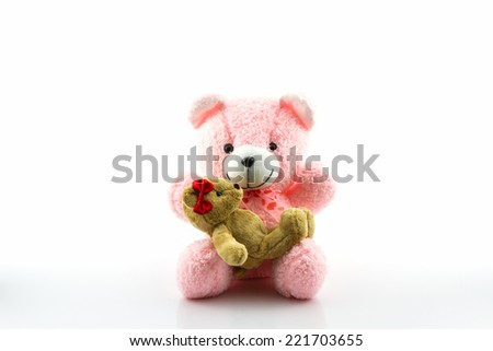 Pink and brown teddy bear on white background.  - stock photo