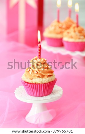 Pink and orange Birthday cupcakes - stock photo