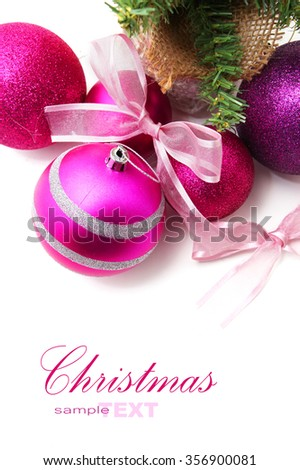 Pink and purple Christmas baubles with a Christmas tree isolated on white background with copy space - stock photo