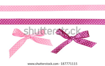 Pink and purple polka dot ribbon with a bow of them isolated on white background - stock photo