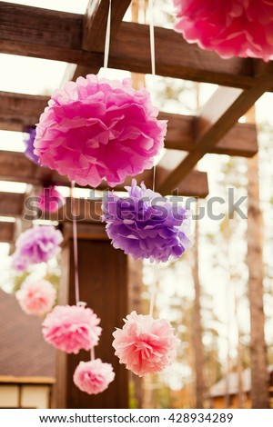 pink and purple pompoms on birthday party - stock photo