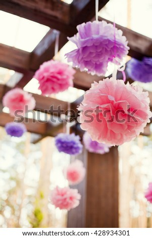 pink and purple pompoms on birthday party