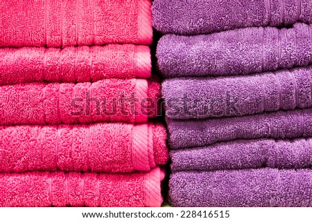 Pink and purple towels as a background - stock photo