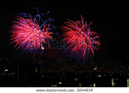 Pink and Red Fireworks display. - stock photo