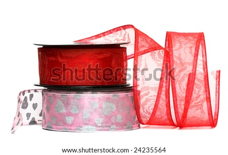 pink and red ribbon on spool isolated on white