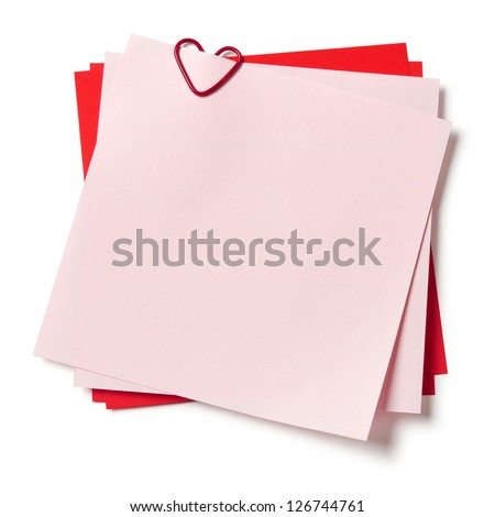 pink and red sticky notes with paper clip in shape of heart on white background - stock photo