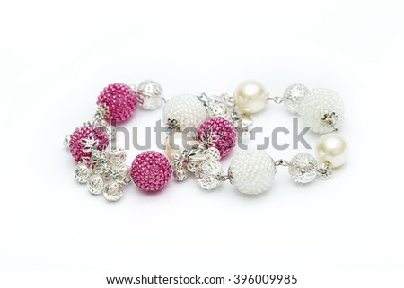 Pink and white beaded bracelets - stock photo