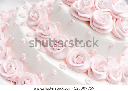 Pink and white delicious luxurious wedding cake with roses - stock photo