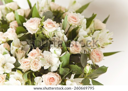 Pink and white flowers background, shallow depth of field. Fresh pink roses. Wedding bouquet with rose bush.  - stock photo