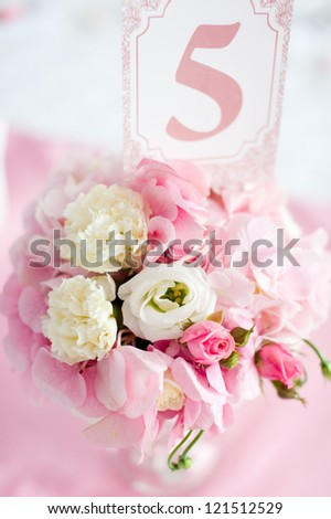 Pink and white flowers with numbers. Celebration - stock photo