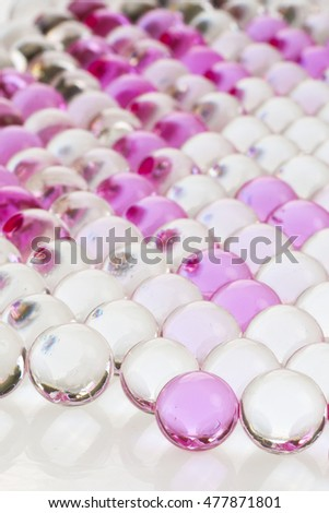 Pink and white jell on white background