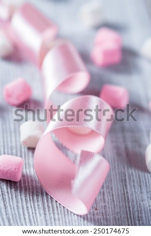 Pink and white marshmallows over wood background.  - stock photo