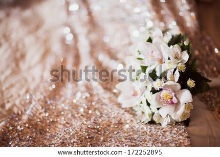 pink and white wedding bouquet and wedding rings