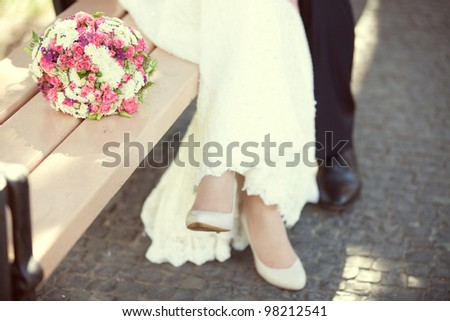 pink and white wedding bouquet  in the hands of the bride