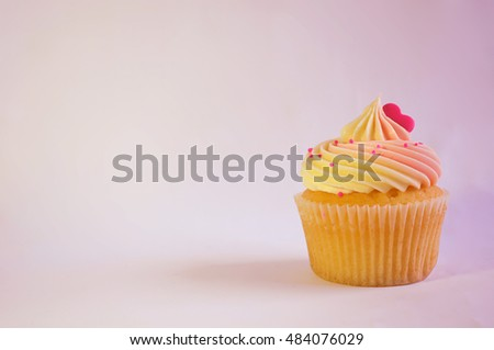 Pink and yellow cupcake