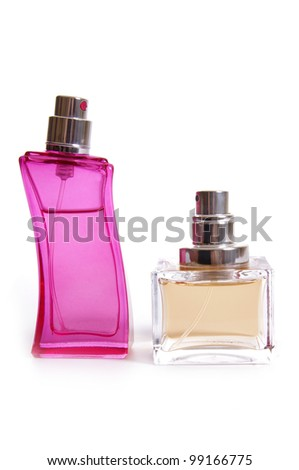 Pink and yellow perfume bottles on white background - stock photo