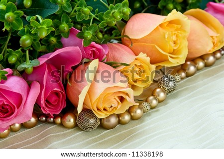 pink and yellow roses w/jewelery - stock photo