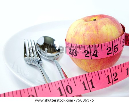 Pink Apple and Yellow pink Measure, Healthcare and diet concept - stock photo