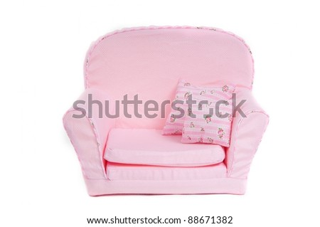 Pink armchair with pillows - stock photo