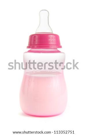 Pink babies bottle half full of milk on white - stock photo