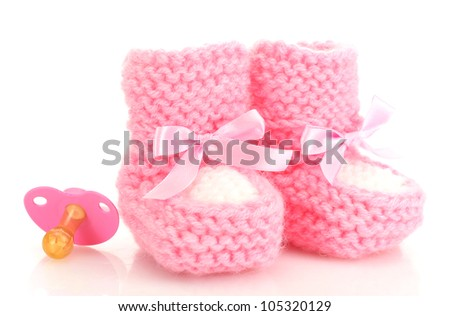pink baby boots and pacifier isolated on white - stock photo