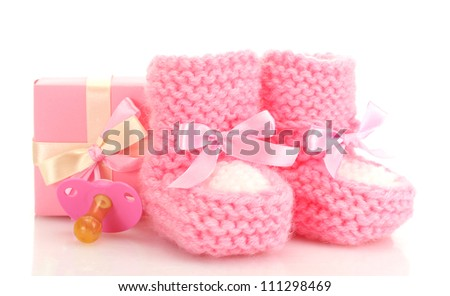 pink baby boots, pacifier and gift isolated on white - stock photo