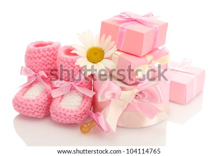 pink baby boots, pacifier, gifts and flower isolated on white - stock photo