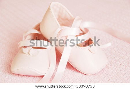 Pink baby girl shoes on the pink blanket - stock photo