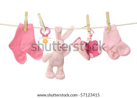 Pink baby goods hanging on the clothesline - stock photo