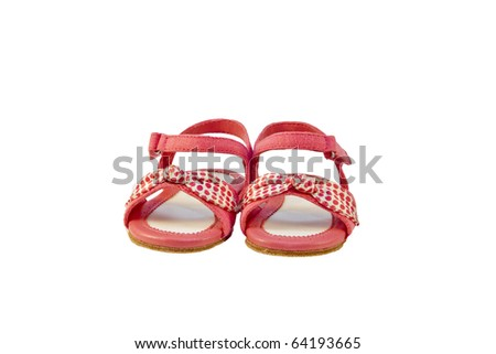 Pink baby sandals with polka dot bow - stock photo