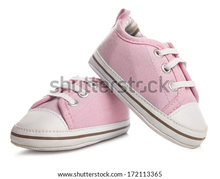 pink baby sneakers on white background - stock photo