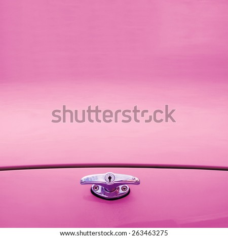 Pink background with trunk lid retro car - stock photo