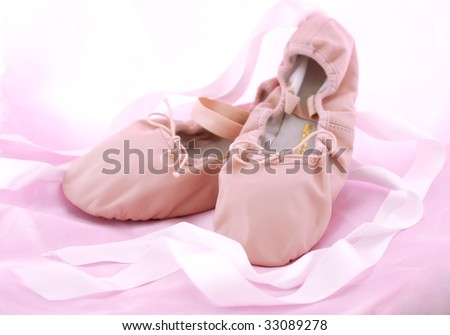 Pink ballet shoes with ribbons - stock photo