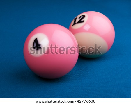 pink balls on blue pool table