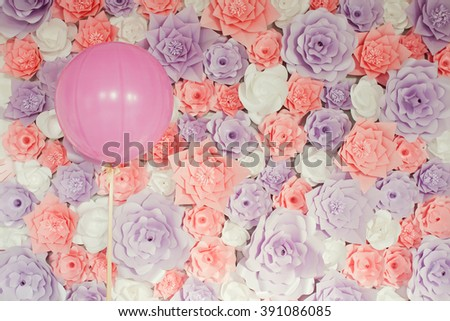pink baloon with paper flowers  - stock photo