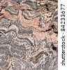 Pink banded gneiss rock - pattern / background - stock photo
