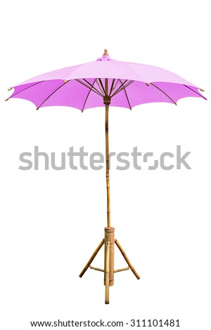 Pink beach umbrella with stand isolated on white, work with clipping path. - stock photo