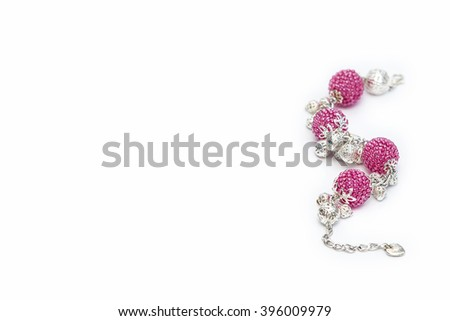 Pink beaded bracelet on the right - stock photo