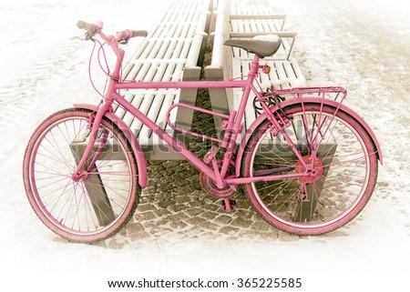 pink bike on a snowy street - stock photo