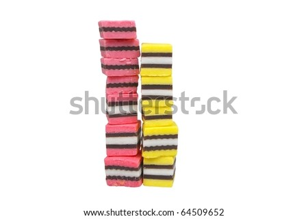 pink black yellow licorice isolated over white - stock photo