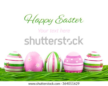 Pink, blue and green easter eggs on a white background - stock photo
