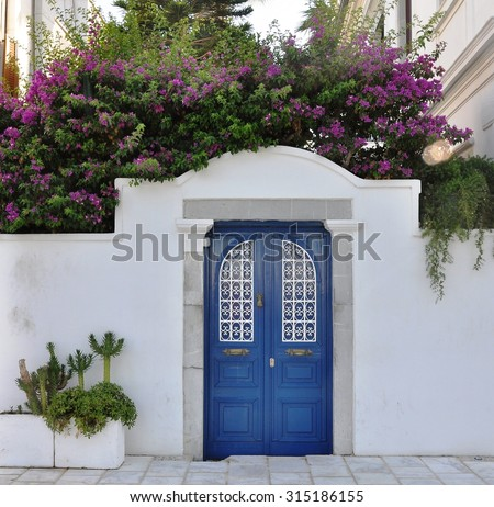 Pink Bougainvillea Flowers and Old Blue Door at Bodrum. Mugla, Turkey - stock photo