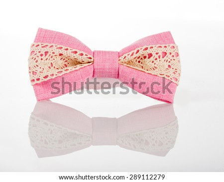 pink bow tie with white lace - stock photo
