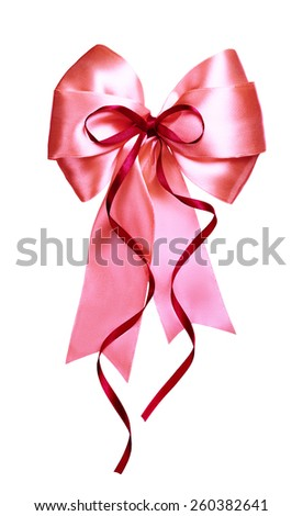 pink bow with red ribbon made from silk isolated - stock photo